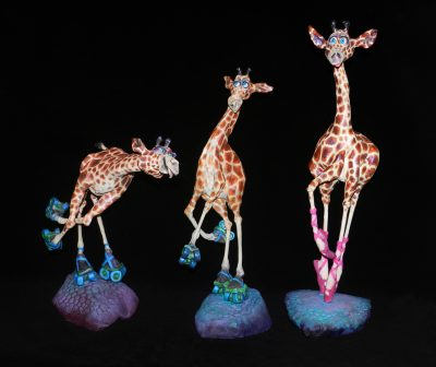 Primagirafferina by Steven Lee Smeltzer cartoonish whimsical clay sculptures of dancing giraffes