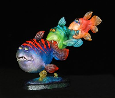 Optimist by Steven Lee Smeltzer cartoonish whimsical clay sculpture of three fish eating each other