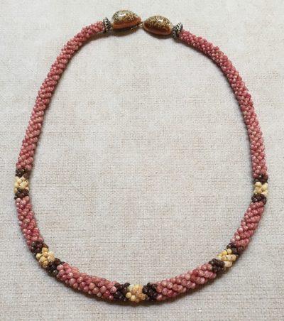 Niihau Lei, 19″ 4-Tie Poepoe with 14K gold-filled clasp. Created by master artisan Mailei Kanahele.