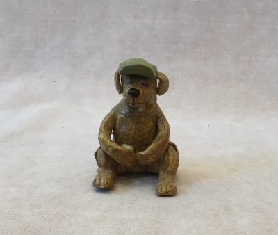 Dog with Hat by Robin Fahey Camerson holding a can hand built clay