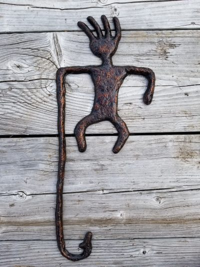 wall hanging aluminum sculpture of a fisherman Petroglyph. A body with a long line and hook hanging below