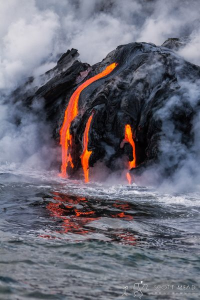 Lava Reflections by Scott Mead lava flowing into ocean
