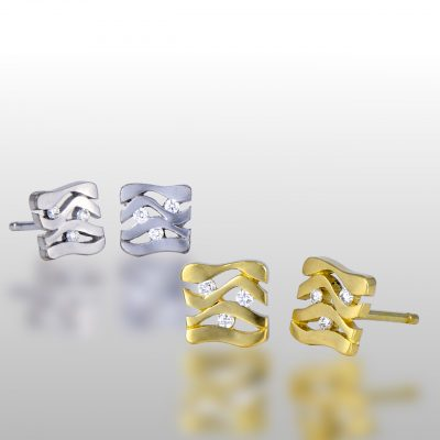 Two pairs of stud earrings. Square shaped made of white and yellow gold. Floating diamonds in the middle