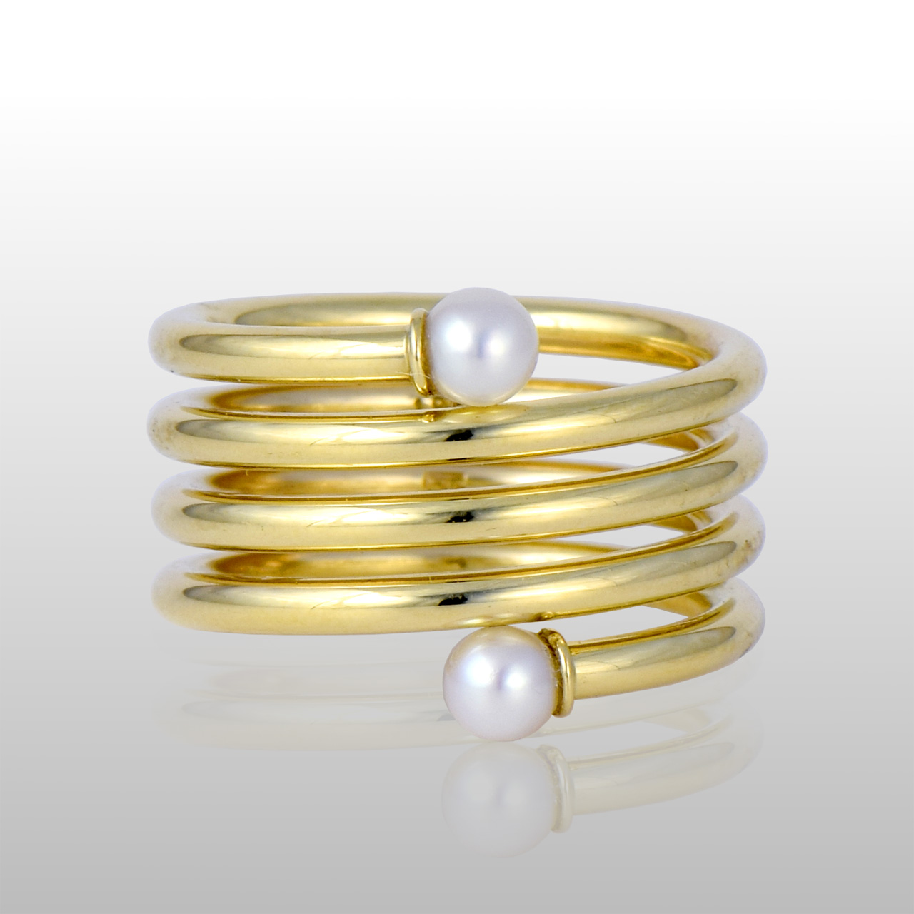 18k yellow gold spirla ring, 5 bands, with a round white pearl on each end