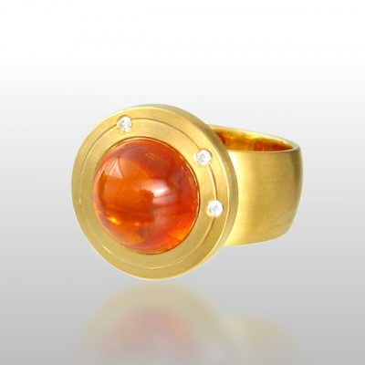 18k Yellow gold ring with a wide band and a round orange stone with 3 diamonds above the stone