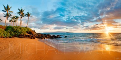 Seascape photo of a beach in Wailea, Maui while the sun sets over the ocean