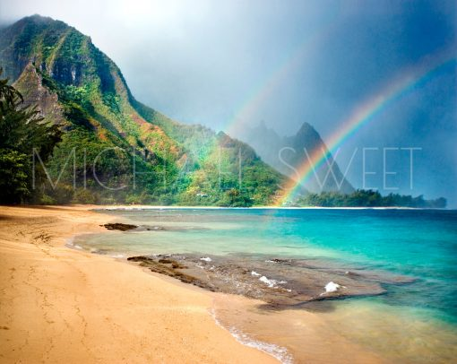 A double rainbow touching the rippled mountains off the coast of Kauai.