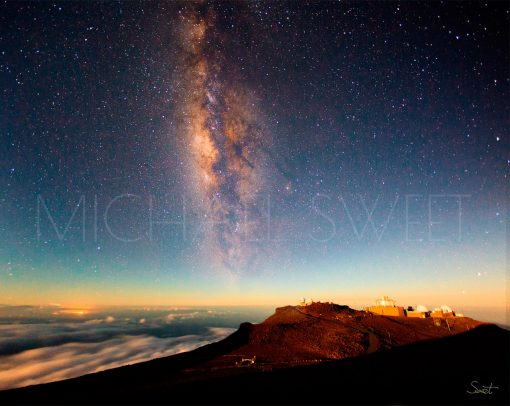 An evening shot atop Haleakala Crater on Maui with the stars milky way visible in the sky