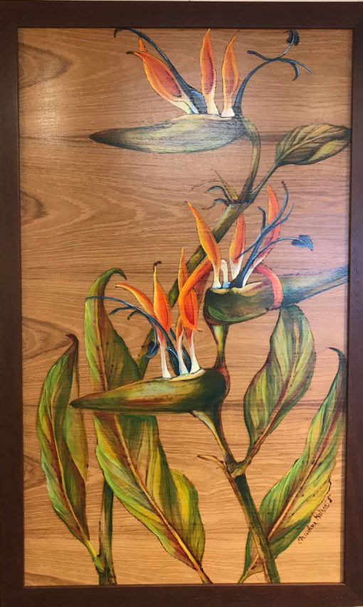 A wood burned and oil painted wood panel of three birds of paradise flowers with leaves