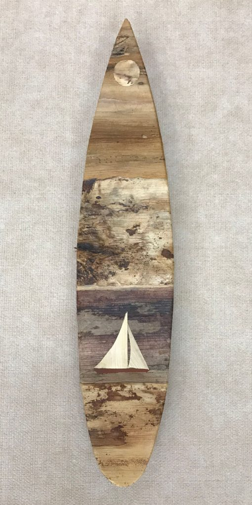 Small surfboard wall hanging from the mind of Baz Cumberbatch. He carves the background from wood, then adds layers of natural fibers by hand