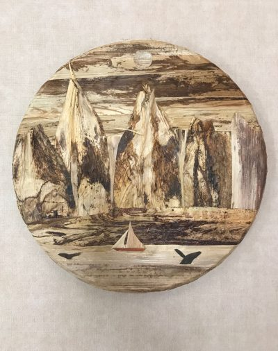 "a 12"" round wall hanging made of various barks with mountain figures, a sailboat, and a breaching whale"