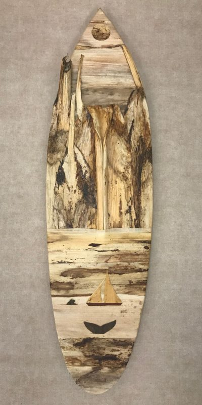 Large surfboard wall hanging from the mind of Baz Cumberbatch. He carves the background from wood, then adds layers of natural fibers by hand