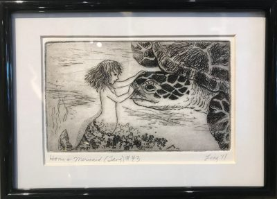 an original print of a mermaid gently touching the face of a large sea turtle