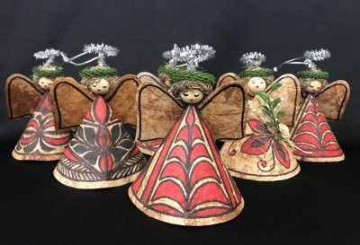 a group of angels made of tapa cloth and other natural fibers