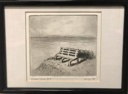 an original print of a bench next to the ocean