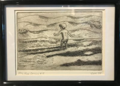 an original print of a young boy standing by the shore as waves crash at his feet