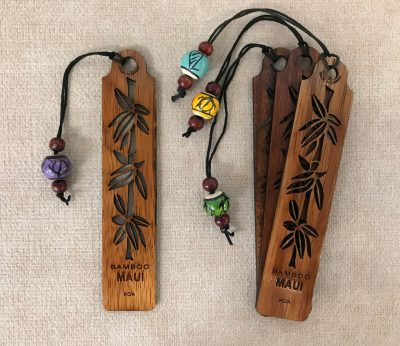 "a bookmark made of Hawaiian Koa wood. Bamboo plant carved out and says ""Maui"" and ""Bamboo"