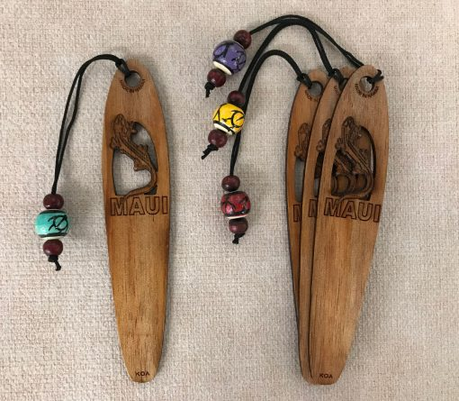 """a bookmark made of Hawaiian Koa wood. A gecko is carved out towards the top half and """"Maui"""" is etched below it"""