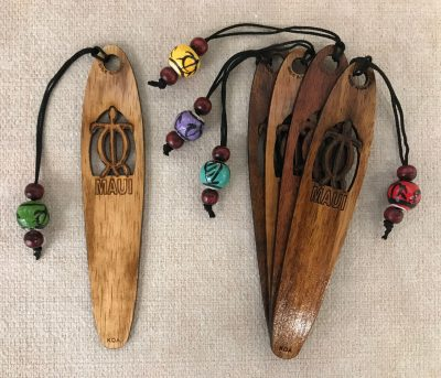 "a bookmark made of Hawaiian Koa wood. A Hawaiian sea turtle is carved and etched out of the top half. 'Maui"" is etched out below the Turtle"