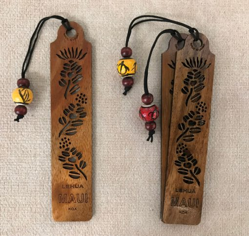 a bookmark made of Hawaiian Koa wood. The Lehua Plant carved and etched out of the entire bookmark