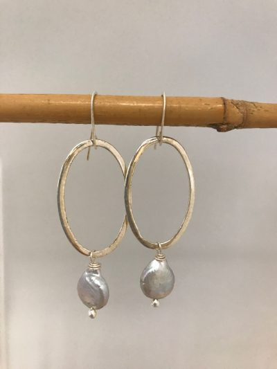 sterling silver oval with a single grey colored coin pearl hanging from the base. On sterling silver ear wires