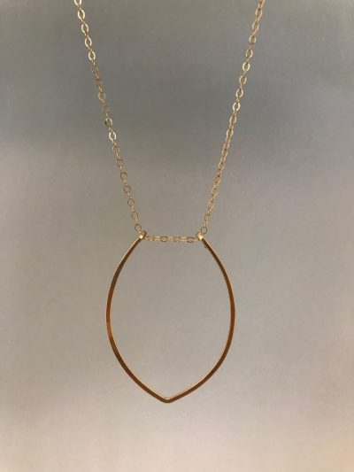 a gold filled petal shaped pendant at the end of a sterling gold filled chain