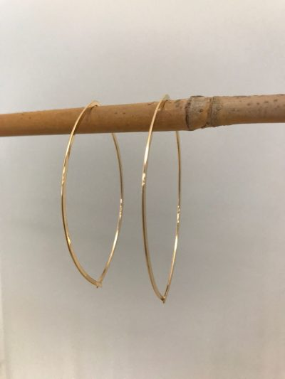 gold filled earrings, oval shaped. Entire earring hooks through ear