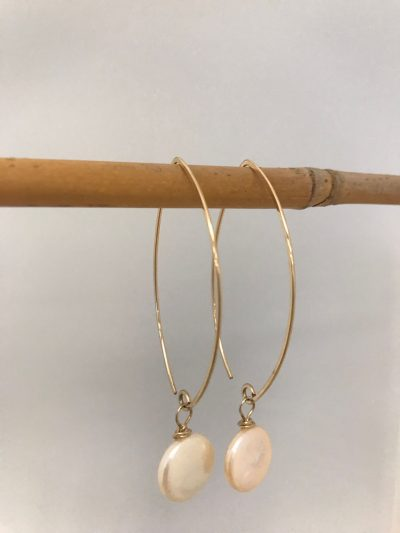 gold filled oval shaped ear wires with a single pink coin pearl handing from the end
