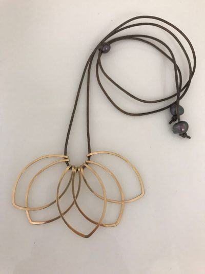 Five gold filled petal shaped pendants at the end of leather cord. Adjustable length with a Tahitian pearl with two additional Tahitian peals at the ends of the cord