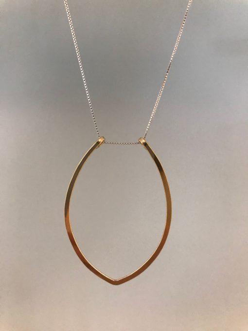 a gold filled petal shaped pendant at the end of a sterling silver chain