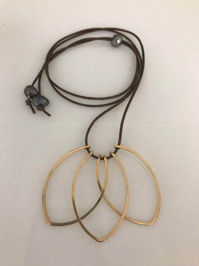 Three gold filled petal shaped pendants at the end of leather cord. Adjustable length with a Tahitian pearl with two additional Tahitian peals at the ends of the cord