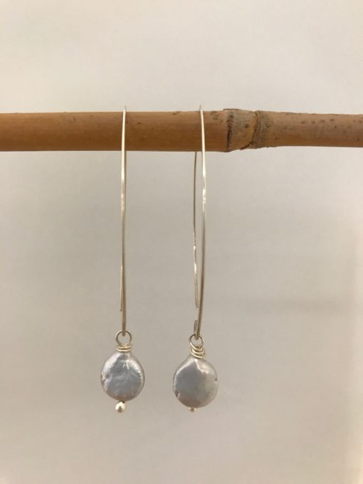 sterling silver oval shaped ear wires with a single pink coin pearl handing from the end