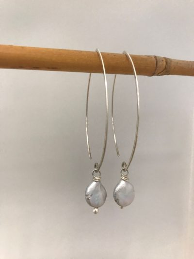 sterling silver oval shaped ear wires with a single grey coin pearl handing from the end