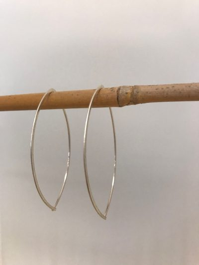 sterling silver earrings, oval shaped. Entire earring hooks through ear
