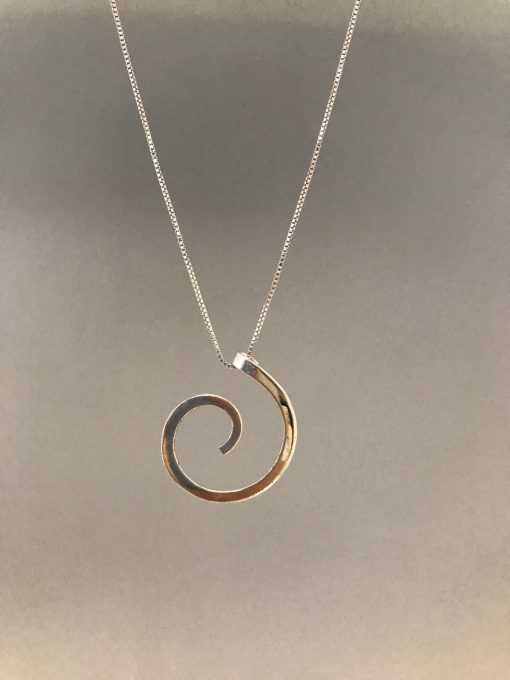 a sterling silver swirl pendant on a sterling silver chain