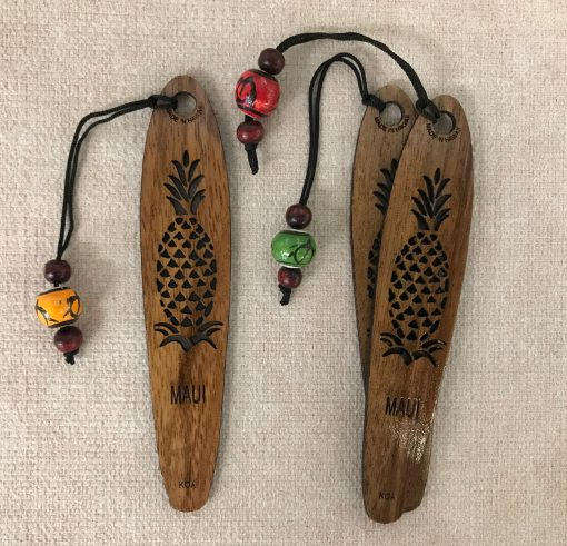 """a bookmark made of Hawaiian Koa Wood. A single pineapple plant carved out of the center with the word """"Maui"""" below it"""