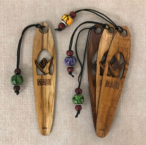 """a bookmark made of Hawaiian Koa wood. A hand in the shape of a Skaka carved out of the center. Says """"Maui"""""""