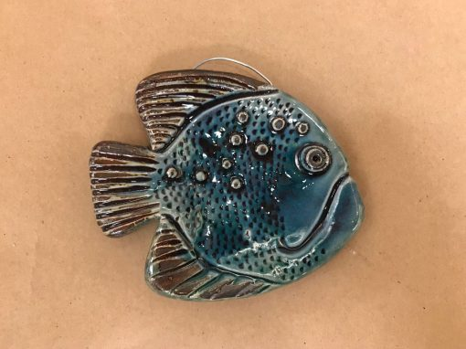 a 4x5 inch fish made of ceramic. Made to hang on the wall. Blue, aqua colored.