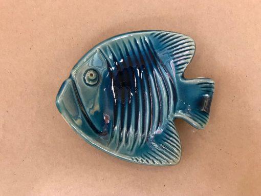 a 4x5 inch fish made of ceramic. Made to lie flat. Blue, aqua colored.