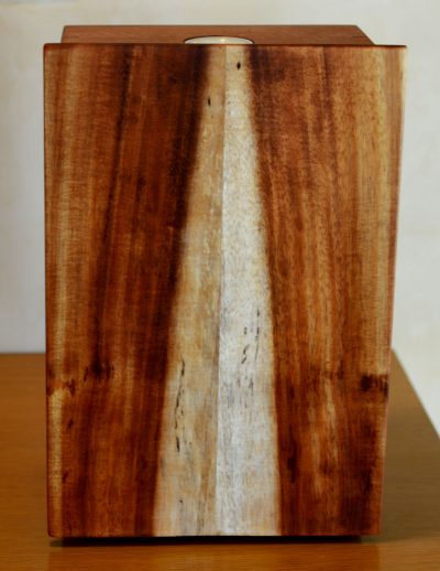 a wooden box made of Koa and Mahogany wood. The lid has both light and dark wood, showing the organic, abstract design of a waterfall.