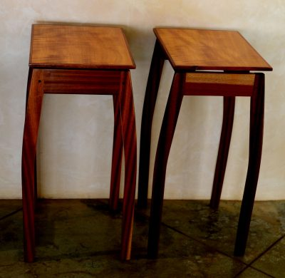 Two end tables made of satinwood and koa wood. Squared Rectangular tops, with thin, curved legs.