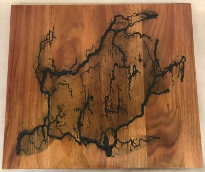 a original wall hanging made of Hawaiian Koa wood. Socked with electricity to form the shape of a Honu, Hawaiian Sea Turtle. Outline of electrical waves is black, against the wood grains.