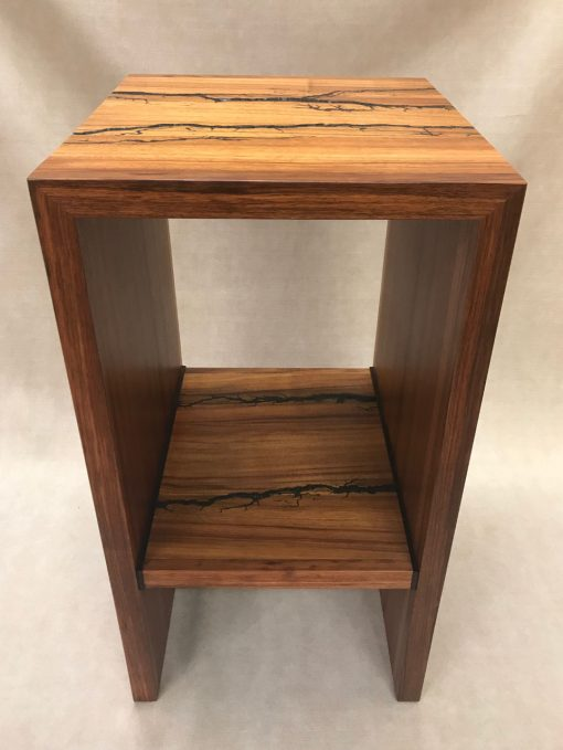 a stand, or shelf made of Hawaiian Koa and Wenge wood. Shocked with electricity to form an organic design. Front View