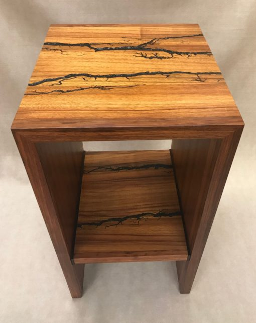 a stand, or shelf made of Hawaiian Koa and Wenge wood. Shocked with electricity to form an organic design. Top View