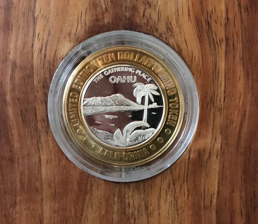 an up close look of the coin which is inlayed in the Oahu Cabinet by Gary Forrest