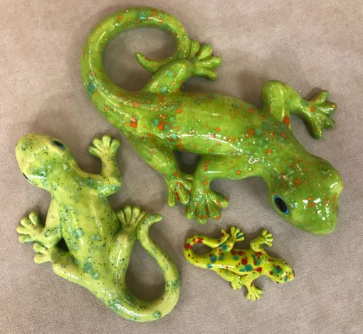 three different sized ceramic geckos with three different shades of green coloring