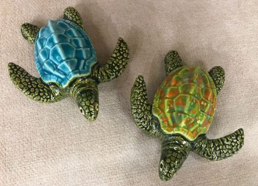 ceramic turtles with ridged shells. Shells are hand painted with various colors
