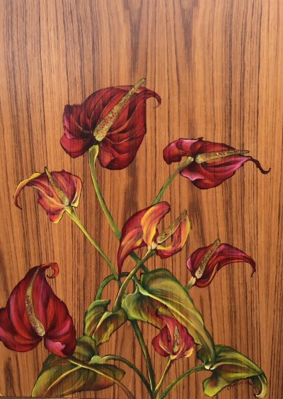 an oil painting of red anthurium flowers on a teak wood panel.