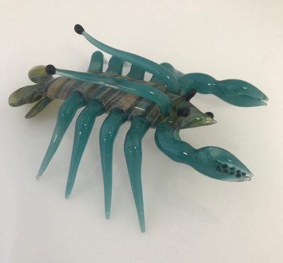 a glass blue and green lobster sculpture.