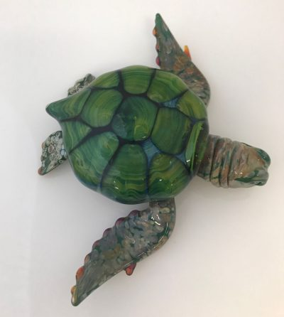 glass honu paperweight. colorful shell